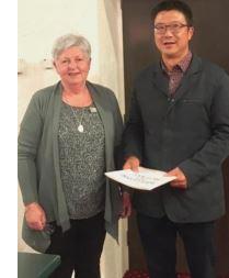 Past President Liz welcomes Peter Bu